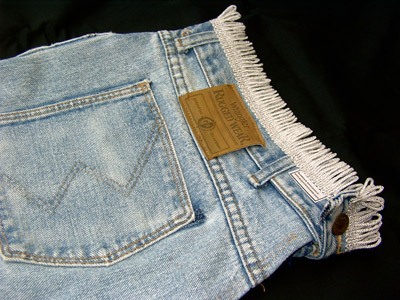 Details of fringe added to baggy jeans bagpipe cover